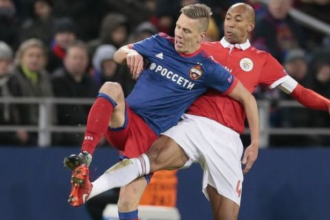 CSKA's Pontus Wernbloom, left, challenges for the ball with Benfica's Luisao during the Champions League Group A soccer match between CSKA Moscow and Benfica in Moscow, Russia, Wednesday, Nov. 22, 2017. (AP Photo/Ivan Sekretarev)