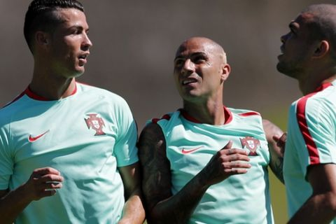 Portugal's Cristiano Ronaldo, Ricardo Quaresma and Pepe, from left to right, attend a training session, on the eve of the Euro 2016 final soccer match between France and Portugal, at Marcoussis, south of Paris, France, Saturday, July 9, 2016. (AP Photo/Francois Mori)