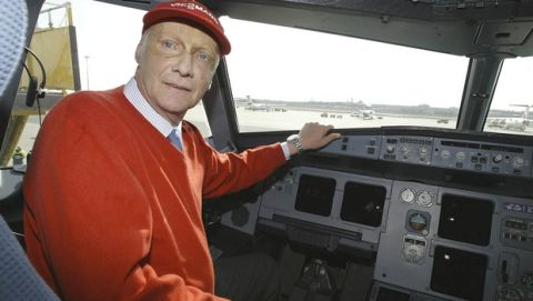 Former Formula One champion Niki Lauda, chief  of the new Austrian discount airline Niki poses in the cockpit of one of his new planes during a press conference at Vienna's airport in Schwechat on Tuesday, March 16, 2004. (AP Photo/Hans Punz)