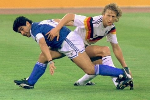 ** FILE ** Argentina's Diego Maradona and West Germany's Guido Buchwald tangle with one another during the World Cup soccer final in Rome on August, 7, 1990, won by the Germans 1-0. Argentina and Germany will meet Friday June 30 in Berlin in a quarterfinal match of the 2006 soccer World Cup. (AP Photo)