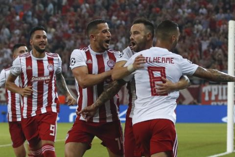 Olympiakos' Mathieu Valbuena, second from right, celebrates after scoring his side's second goal during the Champions League group B soccer match between Olympiakos and Tottenham, at the Georgios Karaiskakis stadium, in Piraeus port, near Athens, Wednesday, Sept. 18, 2019. (AP Photo/Thanassis Stavrakis)
