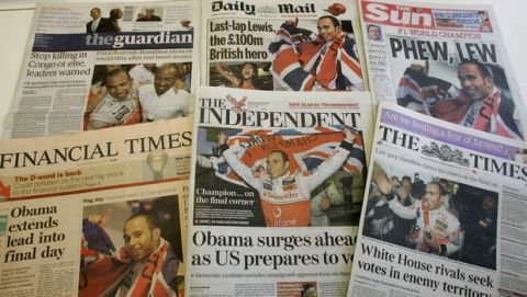 A selection of the front pages of Britian's national papers in London, Monday Nov. 3, 2008, showing the new Formula One Champion Lewis Hamilton celebrating in Sao Paulo, Brazil, late Sunday. Hamilton became Formula One's youngest champion on Sunday, making a last-lap pass to finish fifth in the Brazilian Grand Prix and win the title by one point over Felipe Massa. (AP Photo/ Martin Cleaver )