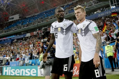 Germany's Toni Kroos, right, celebrates with his teammate Antonio Ruediger after he scored his side's second goal during the group F match between Germany and Sweden at the 2018 soccer World Cup in the Fisht Stadium in Sochi, Russia, Saturday, June 23, 2018. (AP Photo/Frank Augstein)