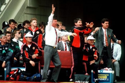 (L-R) Manchester United manager Alex Ferguson, assistant manager Archie Knox and coach Brian Kidd leap off the bench to shout at the referee