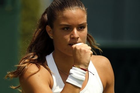 Maria Sakkari of Greece celebrates a point against Saisai Zheng of China during day one of the Wimbledon Tennis Championships in London, Monday, June 27, 2016. (AP Photo/Alastair Grant)