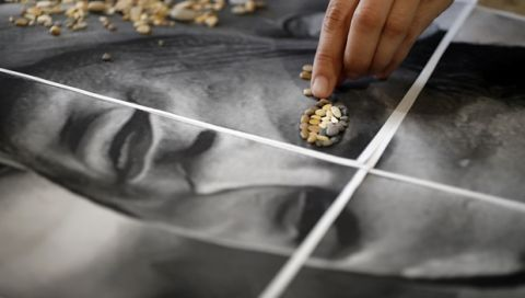 Local artist Anna Solnechnaya is placing pebbles on an image of Brazils' Neymar to create a new piece of stone mosaic ahead of the 2018 soccer World Cup at her workshop in Kazan, Russia, Wednesday, June 13, 2018. Kazan is one of World Cup match venues in Russia. (AP Photo/Eugene Hoshiko)