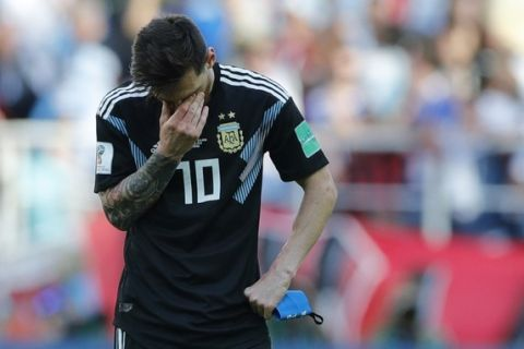 Argentina's Lionel Messi covers his face during the group D match between Argentina and Iceland at the 2018 soccer World Cup in the Spartak Stadium in Moscow, Russia, Saturday, June 16, 2018. (AP Photo/Ricardo Mazalan)