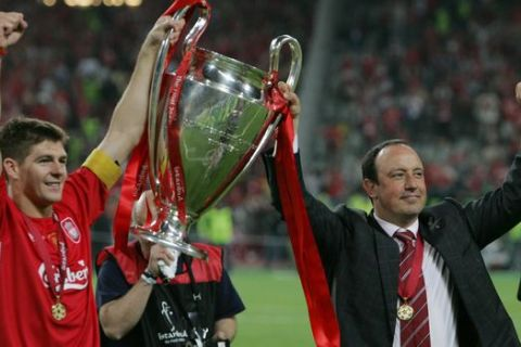 ** CORRECTS NAME OF PHOTOGRAPHER ** Liverpool's captain Steven Gerard, left, and coach Rafael Benitez, hold the trophy after Liverpool's victory in the UEFA Champions League Final between AC Milan and Liverpool at the Ataturk Olympic Stadium in  Istanbul, Turkey,Wednesday May 25, 2005. Liverpool won the match 3-2 on penalties.(AP Photo/Alastair Grant)