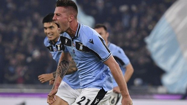 Lazios Sergej Milinkovic-Savic celebrates after he scored his side's second goal during the Serie A soccer match between Lazio and inter Milan, at Rome's Olympic stadium, Sunday, Feb. 16, 2020. (Alfredo Falcone/LaPresse via AP)