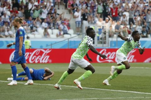Nigeria's Ahmed Musa, right, celebrates after scoring his team's first goal during the group D match between Nigeria and Iceland at the 2018 soccer World Cup in the Volgograd Arena in Volgograd, Russia, Friday, June 22, 2018. (AP Photo/Darko Vojinovic)