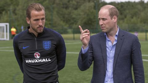 Britain's Prince William, right, talks to England's soccer team captain Harry Kane as he meets members of the England soccer team, during his visit to the FA training ground to meet players ahead of their friendly match against Costa Rica, in Leeds, England, Thursday, June 7, 2018. (Charlotte Graham/Pool Photo via AP)