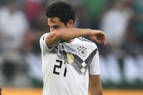 Germany's Ilkay Gundogan, right, walks on the pitch at the end of the friendly soccer match between Germany and Saudi Arabia at BayArena in Leverkusen, Germany, Friday, June 8, 2018. (AP Photo/Martin Meissner)