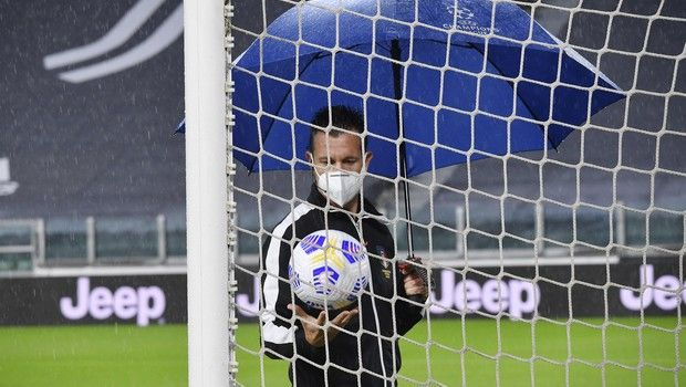 Referee Daniele Doveri inspects the pitch of the Allianz Stadium in Turin, Italy, Sunday, Oct. 4, 2020 ahead of the scheduled Serie A soccer match between Juventus and Napoli. Napoli is likely to be handed a 3-0 loss by the Italian leagues judge for failing to show for its Serie A match at Juventus on Sunday night. Napoli did not travel to Turin for the match after local health authorities ordered the squad into quarantine after two players tested positive for the coronavirus. (Tano Pecoraro/LaPresse via AP)