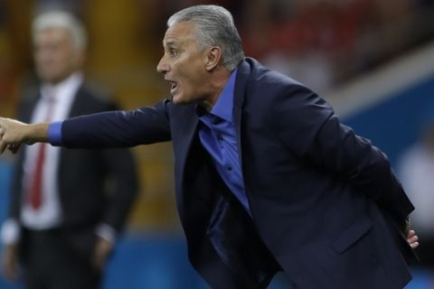 Brazil head coach Tite instructs players during the group E match against Switzerland at the 2018 soccer World Cup in the Rostov Arena in Rostov-on-Don, Russia, Sunday, June 17, 2018. (AP Photo/Andre Penner)
