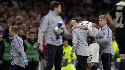 Medics help Tottenham's Jan Vertonghen to leave the field during the Champions League semifinal first leg soccer match between Tottenham Hotspur and Ajax at the Tottenham Hotspur stadium in London, Tuesday, April 30, 2019. (AP Photo/Kirsty Wigglesworth)