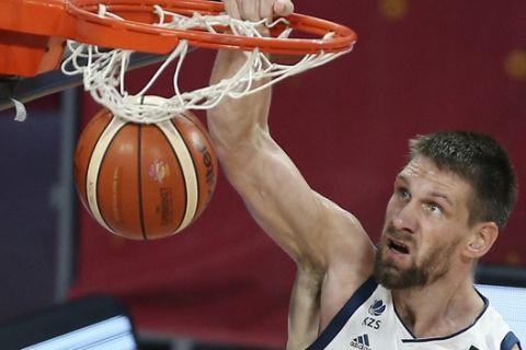 Slovenia's Gasper Vidmar dunks the ball during the Eurobasket European Basketball Championship final match against Serbia in Istanbul, Sunday, Sept. 17. 2017. (AP Photo/Emrah Gurel)