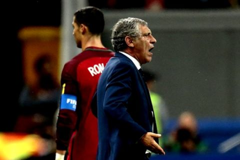 Portugal coach Fernando Santos gestures next to Portugal's Cristiano Ronaldo during the Confederations Cup, semifinal soccer match between Portugal and Chile, at the Kazan Arena, Russia, Wednesday, June 28, 2017. (AP Photo/Ivan Sekretarev)