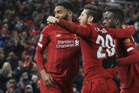 Liverpool's Divock Origi, right, celebrates with teammates after scoring his side's fifth goal during the English League Cup soccer match between Liverpool and Arsenal at Anfield stadium in Liverpool, England, Wednesday, Oct. 30, 2019. (AP Photo/Jon Super)