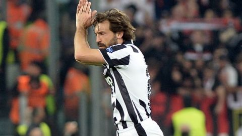 Juventus' Andrea Pirlo applauds fans as he walks off the pitch during the Champions League, quarterfinal, first leg soccer match between Juventus and Monaco, at the Juventus Stadium in Turin, Italy, Tuesday, April 14, 2015. (AP Photo/Massimo Pinca)