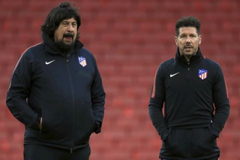 Atletico Madrid manager Diego Simeone, right, and assistant coach German Burgos look on during a soccer squad training session at Emirates Stadium in London, Wednesday, April 25, 2018. Atletico Madrid faces Arsenal in a Europa League match on Thursday.  (Adam Davy/PA Wire)