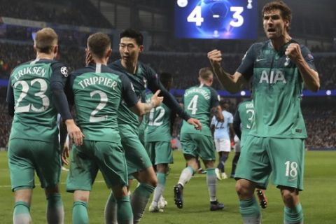 Tottenham Hotspur forward Fernando Llorente, right, celebrates his side's third goal with his teammates during the Champions League quarterfinal, second leg, soccer match between Manchester City and Tottenham Hotspur at the Etihad Stadium in Manchester, England, Wednesday, April 17, 2019. (AP Photo/Jon Super)