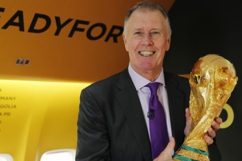 England's 1966 World Cup winner Geoff Hurst holds the FIFA World Cup trophy as he poses for the Associated Press on the first leg of the soccer Wold Cup 2018 trophy tour at Stansted Airport, England, Monday, Jan. 22, 2018. The trophy will visit some 50 countries as it make its journey round the world to Moscow for the start of the World Cup 2018 in Russia. (AP Photo/Alastair Grant)
