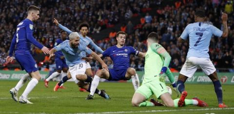 Chelsea goalkeeper Kepa Arrizabalaga, 2nd right, makes a save during the English League Cup final soccer match between Chelsea and Manchester City at Wembley stadium in London, England, Sunday, Feb. 24, 2019. (AP Photo/Alastair Grant)