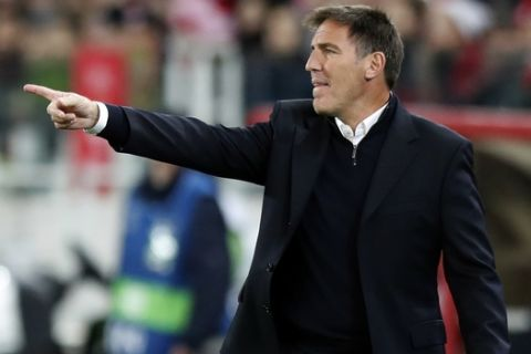 FILE - In this Tuesday, Oct. 17, 2017 file photo, Sevilla's head coach Eduardo Berizzo gestures to his players during their Champions League group E soccer match against Spartak Moscowat the Otkrytiye Arena in Moscow, Russia. Sevilla says it has fired Argentine coach Eduardo Berizzo. His firing on Friday, Dec. 22, 2017 comes a week after Berizzo returned to Sevilla's bench after an absence to receive treatment for a prostate tumor. (AP Photo/Pavel Govolkin, file)