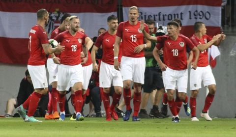 Austria players celebrate after scoring their first goal during a friendly soccer match between Austria and Germany in Klagenfurt, Austria, Saturday, June 2, 2018. (AP Photo/Ronald Zak)