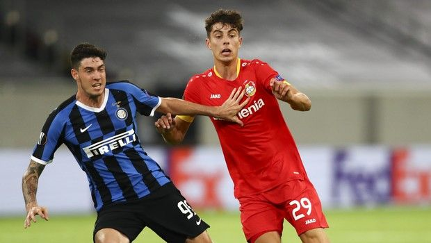 Inter Milan's Alessandro Bastoni, left, and Leverkusen's Kai Havertz battle for the ball during the Europa League quarterfinal match between Inter Milan and Bayer Leverkusen at the Duesseldorf Arena in Dusseldorf, Germany, Monday, Aug. 10, 2020. (Dean Mouhtaropoulos, Pool Photo via AP)