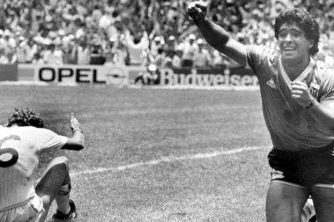 Argentina's Diego Maradona runs across the soccer field in jubilation after he had scored his second goal against England in the World Cup quarter final, in Mexico City, Mexico, on June 22, 1986. England's Terry Butcher sits on the floor. (AP Photo)