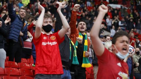 Manchester United fans react before the English Premier League soccer match between Manchester United and Fulham at Old Trafford stadium in Manchester, England, Tuesday, May 18, 2021. (AP Photo/Phil Noble, Pool)