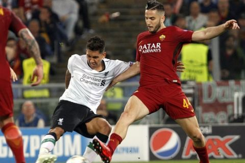 Liverpool's Roberto Firmino, left, is challenged by Roma's Kostas Manolas during the Champions League semifinal second leg soccer match between Roma and Liverpool at the Olympic Stadium in Rome, Wednesday, May 2, 2018. (AP Photo/Riccardo De Luca)