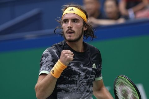 Stefanos Tsitsipas of Greece reacts as he plays against Novak Djokovic of Serbia during the men's singles quarterfinals match at the Shanghai Masters tennis tournament at Qizhong Forest Sports City Tennis Center in Shanghai, China, Friday, Oct. 11, 2019. (AP Photo/Andy Wong)
