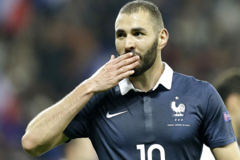 FILE- In this Oct 8, 2015 file photo, France's Karim Benzema reacts after scoring the fourth goal against Armenia during their friendly soccer match in the stadium of Nice, southeastern France. Karim Benzema will not play for France at the European Championship after the French Football Federation decided against his return on Wednesday, April 13, 2016. (AP Photo/Lionel Cironneau, File)