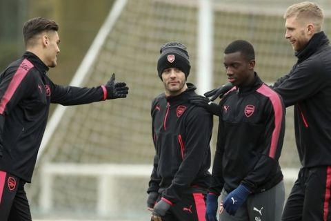 Arsenal's Jack Wilshere, second left, attends a training session with teammates at London Colney, Wednesday Feb. 21, 2018. (Adam Davy/PA via AP)