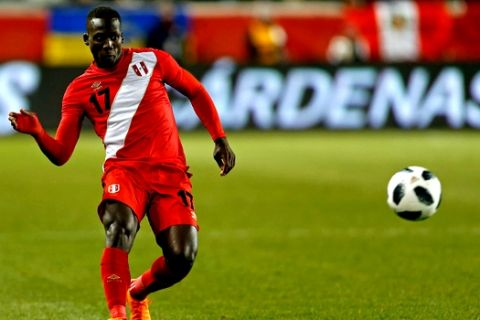 In this photo taken on Tuesday, March 27, 2018 Peru defender Luis Advincula in action against Iceland during the second half of an international friendly soccer match Tuesday, in Harrison, N.J. (AP Photo/Adam Hunger)