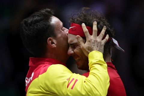 Spain's Rafael Nadal celebrates with teammate Roberto Bautista Agut, left, after defeating Canada's Denis Shapovalov in their tennis singles match to win the Davis Cup final in Madrid, Spain, Sunday, Nov. 24, 2019. (AP Photo/Manu Fernandez)