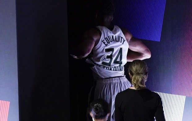 Milwaukee Bucks' Giannis Antetokounmpo leaves the court after hurting his ankle during the first half of an NBA conference semifinal playoff basketball game against the Miami Heat Sunday, Sept. 6, 2020, in Lake Buena Vista, Fla. (AP Photo/Mark J. Terrill)