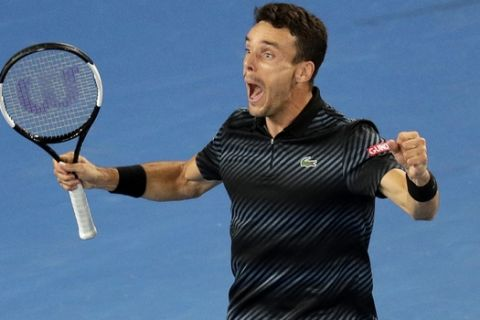 Spain's Roberto Bautista Agut celebrates after defeating Croatia's Marin Cilic in their fourth round match at the Australian Open tennis championships in Melbourne, Australia, Sunday, Jan. 20, 2019. (AP Photo/Kin Cheung)