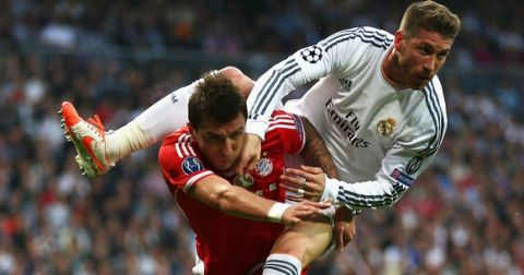 MADRID, SPAIN - APRIL 23: Sergio Ramos of Real Madrid climbs on Mario Mandzukic of Bayern Muenchen during the UEFA Champions League semi-final first leg match between Real Madrid and FC Bayern Muenchen at the Estadio Santiago Bernabeu on April 23, 2014 in Madrid, Spain.  (Photo by Paul Gilham/Getty Images)