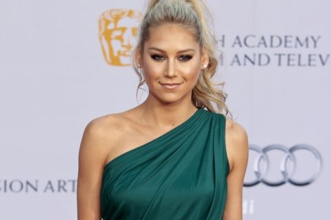 Tennis star Anna Kournikova poses at the BAFTA Brits to Watch dinner Saturday, July 9, 2011, at the Belasco Theatre in Los Angeles. (AP Photo/Bret Hartman)