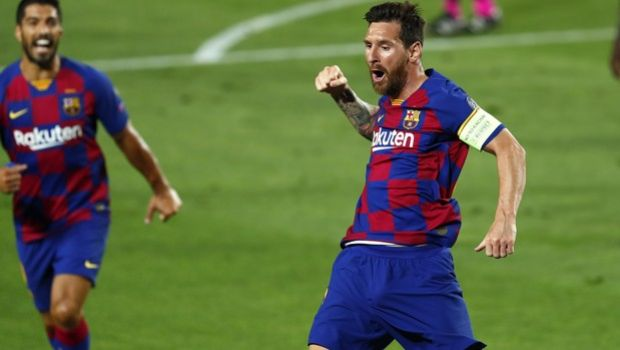Barcelona's Lionel Messi, right, celebrates after scoring his side's second goal during the Champions League round of 16, second leg soccer match between Barcelona and Napoli at the Camp Nou Stadium in Barcelona, Spain, Saturday, Aug. 8, 2020. (AP Photo/Joan Monfort)