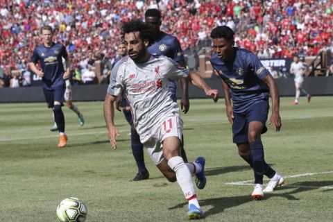 Liverpool midfielder Mohamed Salah (11) controls the ball during the first half of an International Champions Cup tournament soccer match against Manchester United, Saturday, July 28, 2018, in Ann Arbor, Mich. (AP Photo/Carlos Osorio)