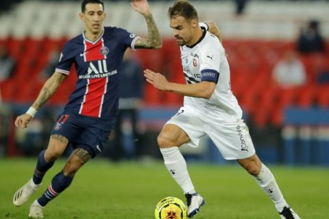 Rennes' Damien Da Silva is challenge day PSG's Angel Di Maria during the French League One soccer match between Paris Saint-Germain and Rennes at the Parc des Princes in Paris, France, Saturday, Nov. 7, 2020. (AP Photo/Christophe Ena)