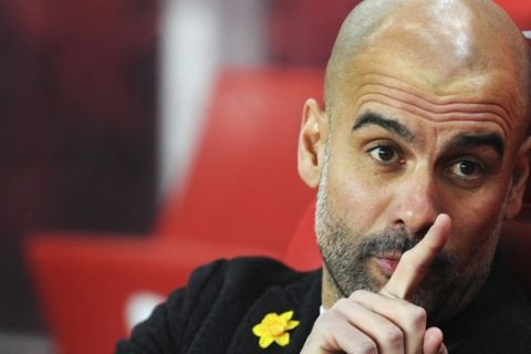 Manchester City manager Josep Guardiola gestures before the English Premier League soccer match between Stoke City and Manchester City at the Bet 365 Stadium in Stoke on Trent, England, Monday, March 12, 2018. (AP Photo/Rui Vieira)