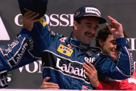 British driver Nigel Mansell celebrates his victory together with third placed French driver Jean Alesi in Hockenheim July 28, 1991.  Mansell won the Formula-1 Grand Prix of Germany in Hockenheim.  (AP Photo/KARSTEN THIELKER)