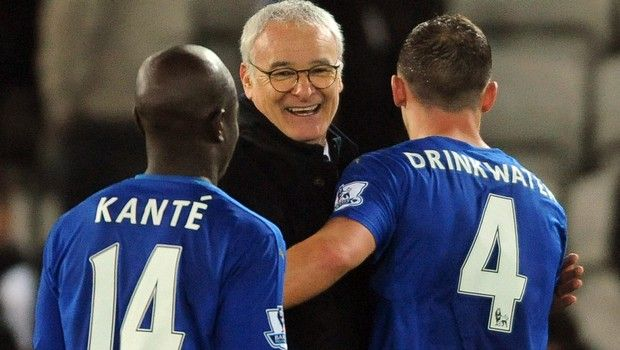 Leicester manager Claudio Ranieri congratulates Daniel Drinkwater, right, and Ngolo Kante, left, after the English Premier League soccer match between Leicester City and Newcastle United at the King Power Stadium in Leicester, England, Monday, March 14, 2016. (AP Photo/Rui Vieira)