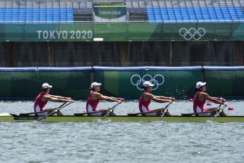 Chen Yunxia, Zhang Ling, Lyu Yang, Cui Xiaotong of China compete during the women's rowing quadruple sculls heat at the 2020 Summer Olympics, Friday, July 23, 2021, in Tokyo, Japan. (AP Photo/Lee Jin-man)