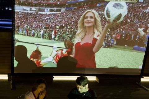Soccer fans prepare to watch the live broadcast of the 2018 soccer World Cup in Beijing, China, Thursday, June 14, 2018. (AP Photo/Ng Han Guan)